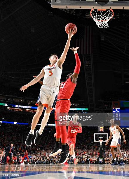 Kyle Guy of the Virginia Cavaliers attempts a shot against Norense Odiase of the Texas Tech Red Raiders in the second half during the 2019 NCAA men's...