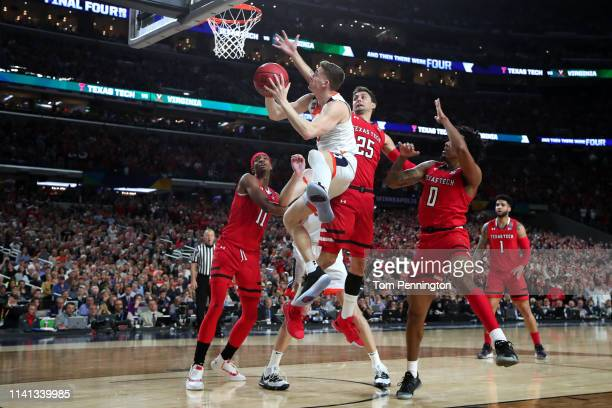 Kyle Guy of the Virginia Cavaliers attempts a shot against the Texas Tech Red Raiders during the 2019 NCAA men's Final Four National Championship...