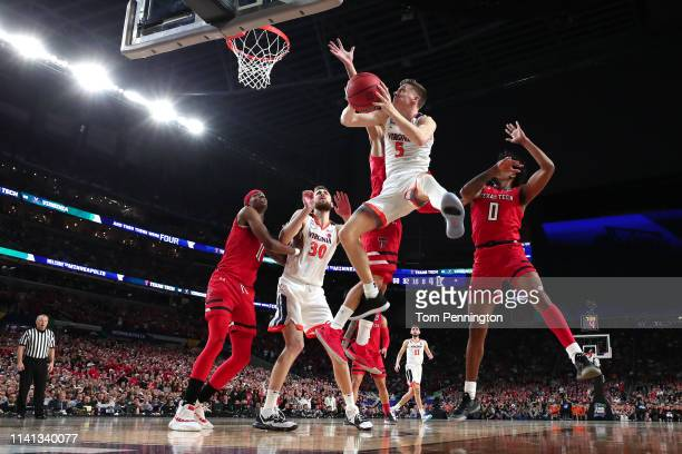 Kyle Guy of the Virginia Cavaliers attempts a shot against the Texas Tech Red Raiders in the first half during the 2019 NCAA men's Final Four...