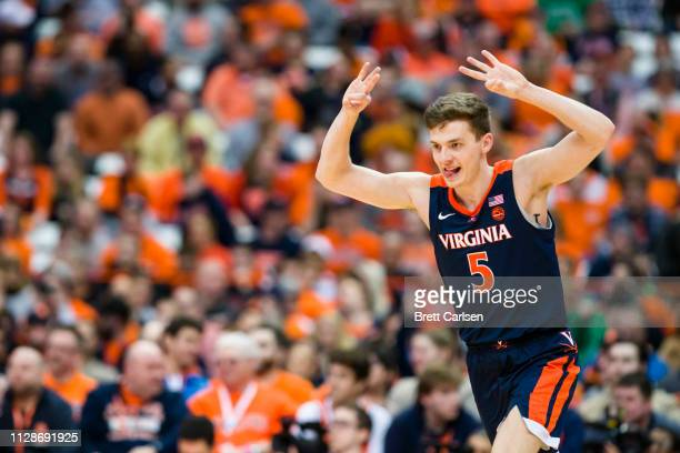 Kyle Guy of the Virginia Cavaliers celebrates a teammate's three point basket during the second half against the Syracuse Orange at the Carrier Dome...