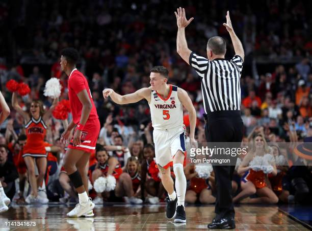 Kyle Guy of the Virginia Cavaliers celebrates a three point basket against the Texas Tech Red Raiders in the second half during the 2019 NCAA men's...