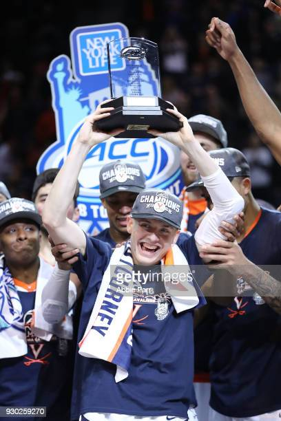 Kyle Guy of the Virginia Cavaliers celebrates after being named tournament MVP after defeating the North Carolina Tar Heels 7163 during the...
