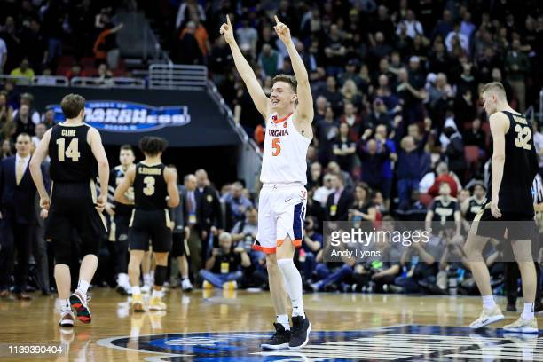 Kyle Guy of the Virginia Cavaliers celebrates after defeating the Purdue Boilermakers 80-75 to advance to the Final Four in overtime of the 2019 NCAA...