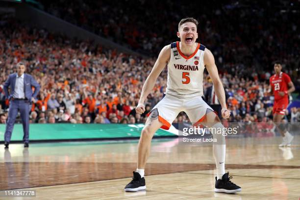 Kyle Guy of the Virginia Cavaliers celebrates his teams lead in overtime against the Texas Tech Red Raiders during the 2019 NCAA men's Final Four...