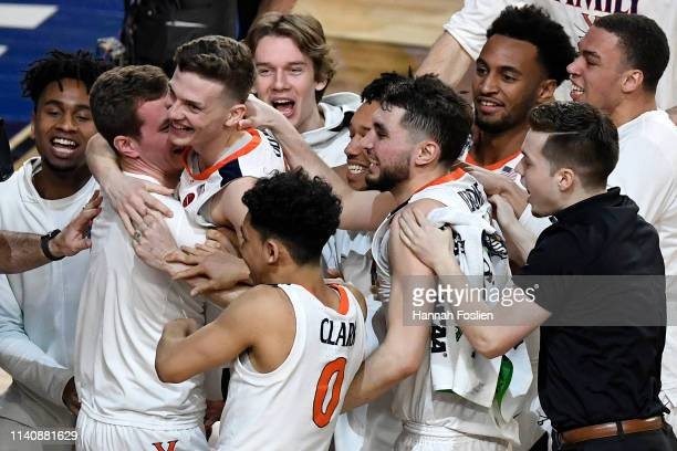 Kyle Guy of the Virginia Cavaliers celebrates with teammates after defeating the Auburn Tigers 6362 during the 2019 NCAA Final Four semifinal at US...