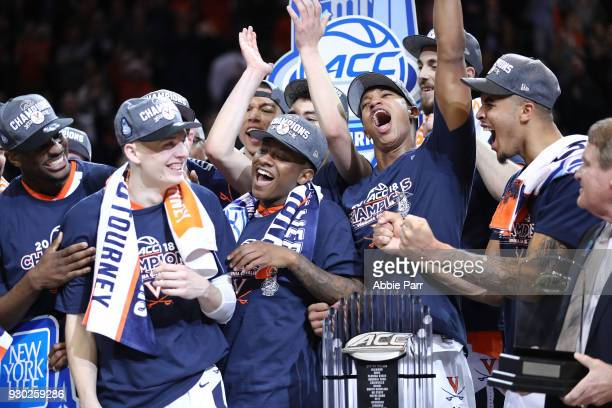 Kyle Guy of the Virginia Cavaliers celebrates with teammats after being named tournament MVP after defeating the North Carolina Tar Heels 7163 during...