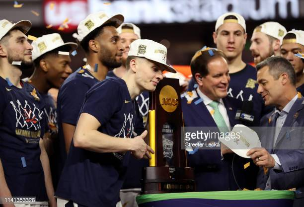 Kyle Guy of the Virginia Cavaliers celebrates with the trophy after his teams 8577 win over the Texas Tech Red Raiders to win the 2019 NCAA men's...