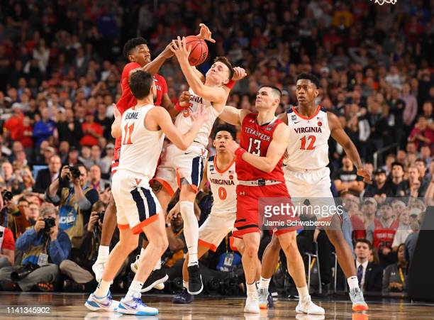 Kyle Guy of the Virginia Cavaliers competes for a loose ball against the Texas Tech Red Raiders during the second half of the 2019 NCAA men's Final...