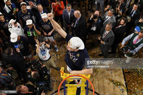 Kyle Guy of the Virginia Cavaliers cuts down the net after defeating the Texas Tech Red Raiders during the 2019 NCAA Photos via Getty Images Men's...