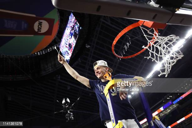 Kyle Guy of the Virginia Cavaliers cuts down the net after his teams 8577 win over the Texas Tech Red Raiders during the 2019 NCAA men's Final Four...