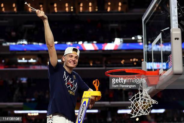 Kyle Guy of the Virginia Cavaliers cuts down the net after his teams 85-77 win over the Texas Tech Red Raiders during the 2019 NCAA men's Final Four...