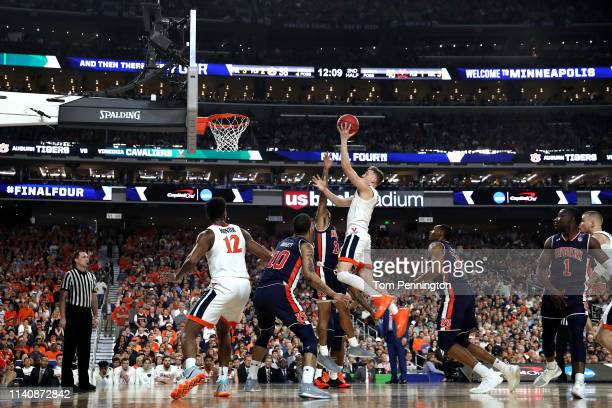 Kyle Guy of the Virginia Cavaliers drives to the basket against J'Von McCormick of the Auburn Tigers in the second half during the 2019 NCAA Final...