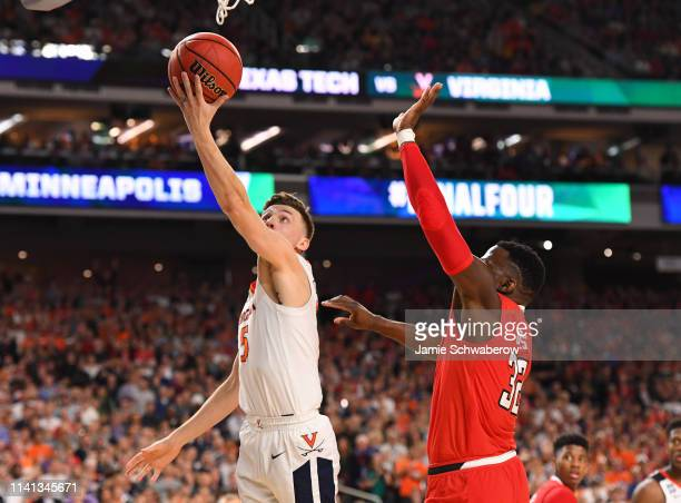 Kyle Guy of the Virginia Cavaliers drives to the basket against Norense Odiase of the Texas Tech Red Raiders during the second half of the 2019 NCAA...