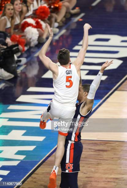 Kyle Guy of the Virginia Cavaliers is fouled by Bryce Brown of the Auburn Tigers during the second half of the semifinal game in the NCAA Photos via...