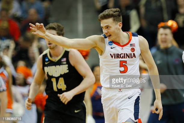 Kyle Guy of the Virginia Cavaliers reacts after a three pointer against the Purdue Boilermakers during the second half of the 2019 NCAA Men's...