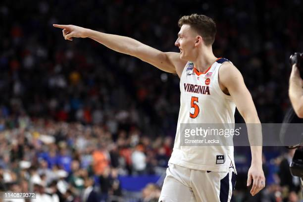 Kyle Guy of the Virginia Cavaliers reacts after defeating the Auburn Tigers 6362 during the 2019 NCAA Final Four semifinal at US Bank Stadium on...