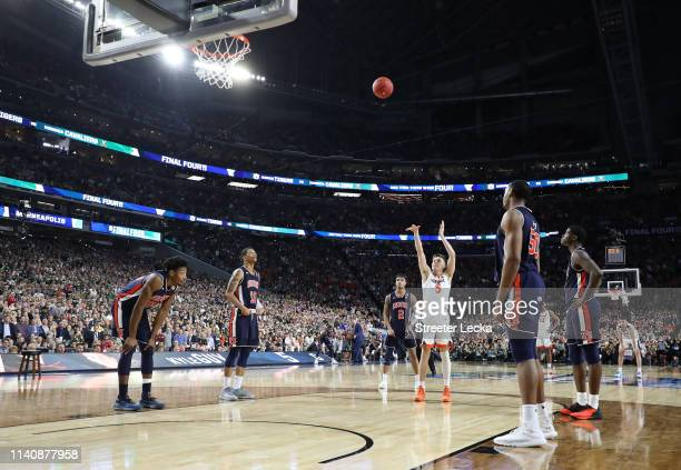Kyle Guy of the Virginia Cavaliers shoots a free throw late in the second half against the Auburn Tigers during the 2019 NCAA Final Four semifinal at...