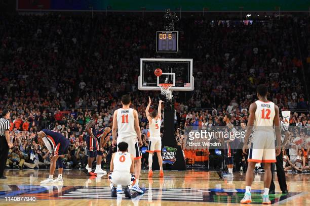 Kyle Guy of the Virginia Cavaliers shoots a late game free throw during the second half of the semifinal game in the NCAA Men's Final Four at US Bank...