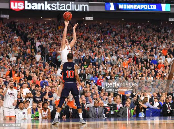 Kyle Guy of the Virginia Cavaliers shoots a three pointer over Samir Doughty of the Auburn Tigers during the second half of the semifinal game in the...