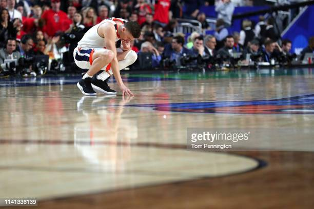 Kyle Guy of the Virginia Cavaliers takes a moment prior to the 2019 NCAA men's Final Four National Championship game against the Texas Tech Red...