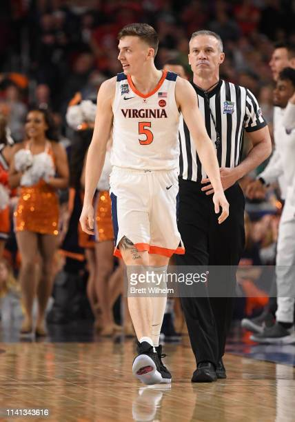 Kyle Guy of the Virginia Cavaliers walks up the court during the second half of the game against the Texas Tech Red Raiders in the 2019 NCAA men's...