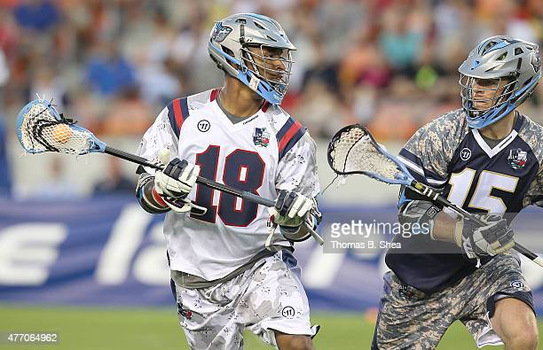 Kyle Harrison Gladiators drives against Peter Baum of the Cowboys in the second half during the 2015 MLL All Star Game on June 13 2015 at BBVA...
