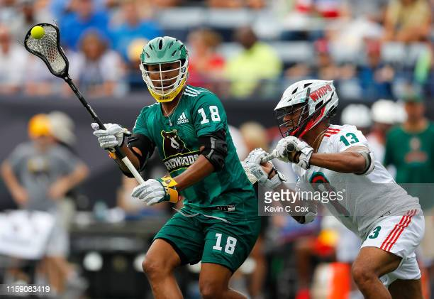 Kyle Harrison of Redwoods LC passes against Ty Warner of Whipsnakes LC during day two of the Premier Lacrosse League at Georgia State Stadium on June...