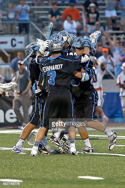Kyle Harrison of the Ohio Machine is congratulated by his teammates after scoring the game winning goal in overtime against the Denver Outlaws on...