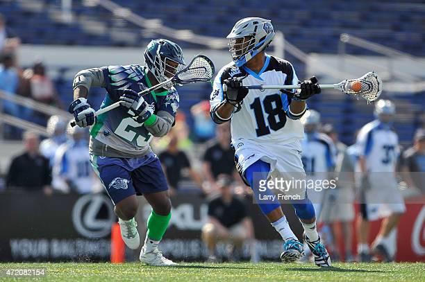 Kyle Harrison of the Ohio Machine moves the ball against Jovan Miller of the Chesapeake Bayhawks at NavyMarine Corps Memorial Stadium on May 3 2015...