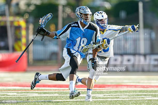 Kyle Harrison of the Ohio Machine runs the ball past Cameron LaoGosney of the Florida Launch during the first quarter on May 24 2015 at Selby Stadium...