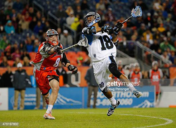 Kyle Harrison of the Ohio Machine takes a shot against Gregory Downing of the Denver Outlaws at Sports Authority Field at Mile High on May 29 2015 in...