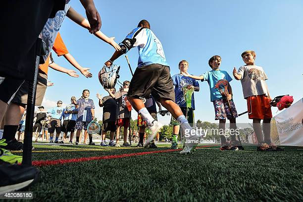 Kyle Harrison of the Ohio Machine takes the field through a tunnel of fans before a game against the Boston Cannons on July 25 2015 at Selby Stadium...
