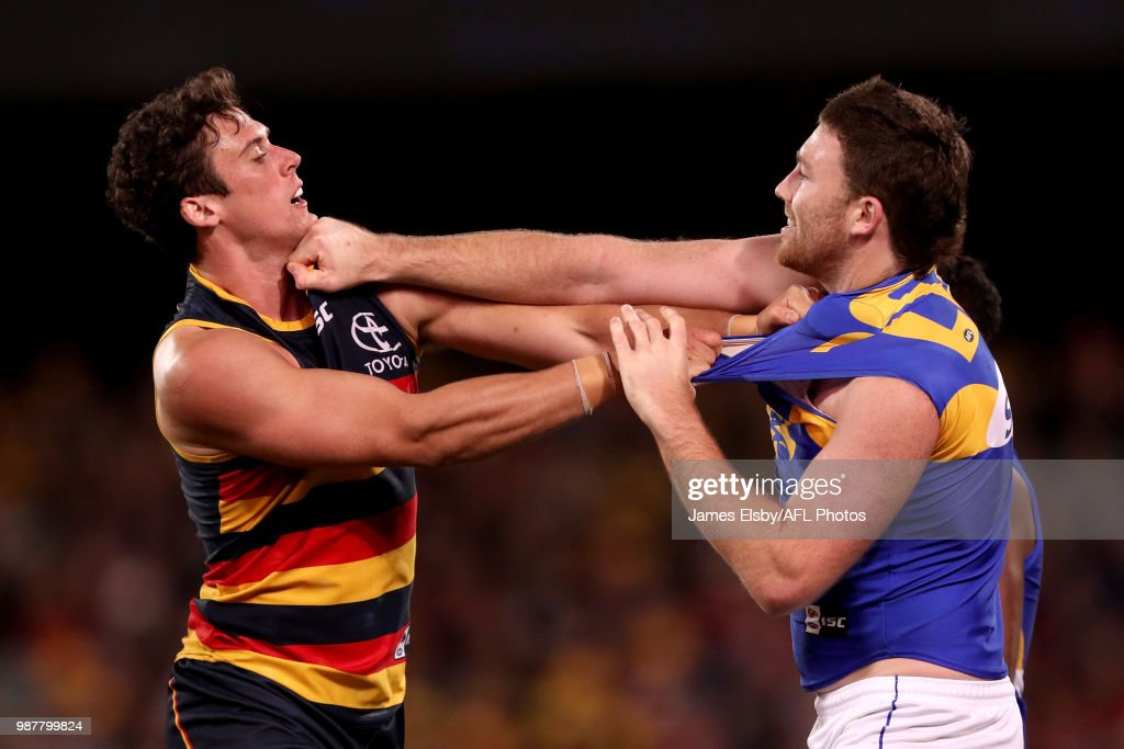Kyle Hartigan of the Crows clashes with Jeremy McGovern of the Eagles during the 2018 AFL round15 match between the Adelaide Crows and the West Coast Eagles at the Adelaide Oval on June 30, 2018 in Adelaide, Australia.