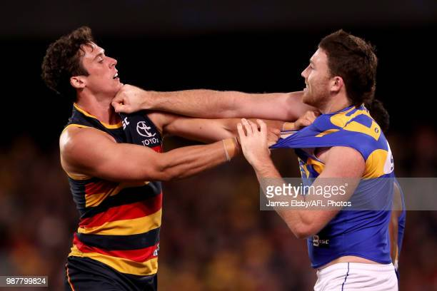 Kyle Hartigan of the Crows clashes with Jeremy McGovern of the Eagles during the 2018 AFL round15 match between the Adelaide Crows and the West Coast...