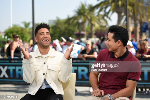 Kyle Harvey and Mario Lopez visit 'Extra' at Universal Studios Hollywood on August 16 2018 in Universal City California