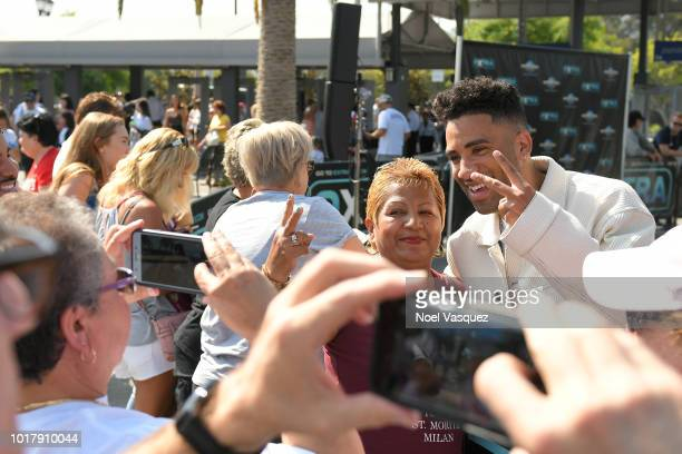 Kyle Harvey poses for pictures with fans at 'Extra' at Universal Studios Hollywood on August 16 2018 in Universal City California