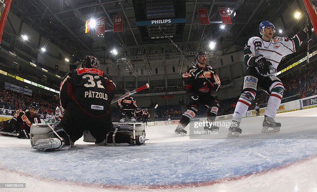 Kyle Helms (R) of Augsburg celebrates hi steam's 3rd goal during the DEL match between Hannover Scorpions and Augsburger Panther at TUI Arena at TUI Arena on January 9, 2013 in Hanover, Germany.