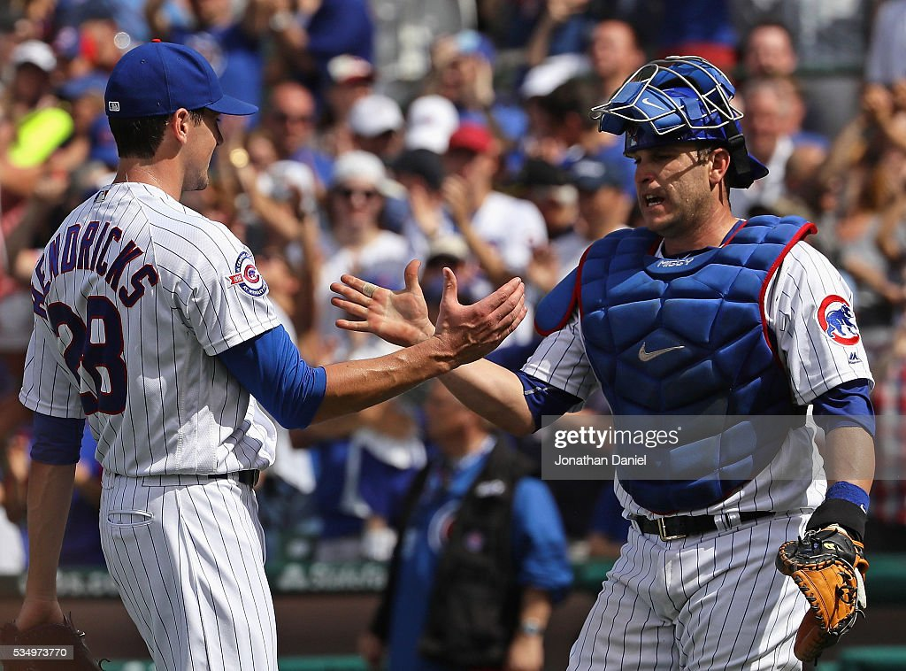 Kyle Hendricks #28 and Miguel Montero #47 of the Chicago Cubs celebrate a win over the Philadelphia Phillies at Wrigley Field on May 28, 2016 in Chicago, Illinois. The Cubs defeated the Phillies 4-1.