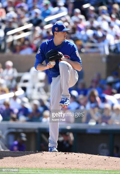 Kyle Hendricks of the Chicago Cubs delivers a first inning pitch during a spring training game against the Colorado Rockies at Salt River Fields at...