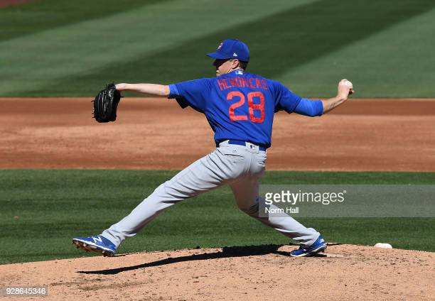 Kyle Hendricks of the Chicago Cubs delivers a pitch during a spring training game against the Colorado Rockies at Salt River Fields at Talking Stick...