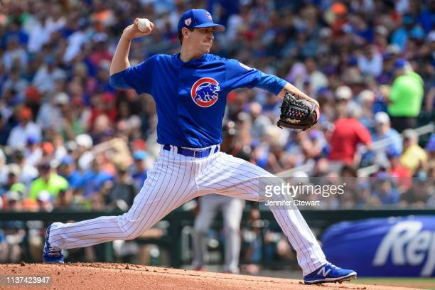 Kyle Hendricks of the Chicago Cubs delivers a pitch during the spring training game against the San Francisco Giants at Sloan Park on March 21 2019...