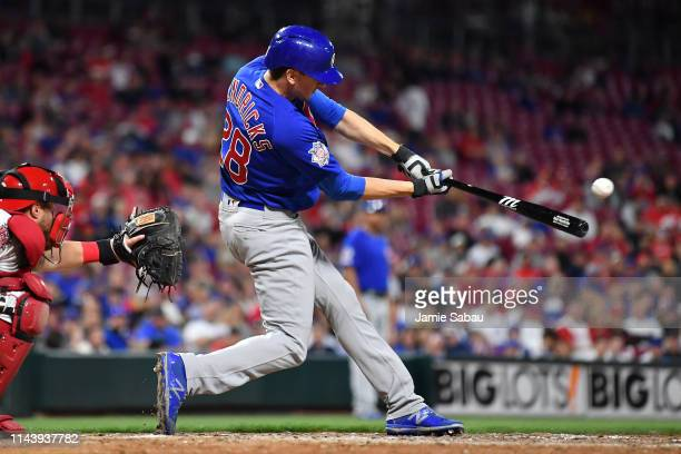 Kyle Hendricks of the Chicago Cubs hits a single in the ninth inning against the Cincinnati Reds at Great American Ball Park on May 14 2019 in...