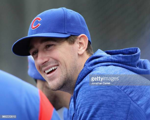 Kyle Hendricks of the Chicago Cubs is seen talking to a teammate in the dugout during the Opening Day home game against the Pittsburgh Pirates at...
