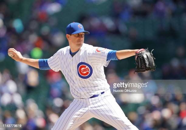 Kyle Hendricks of the Chicago Cubs pitches in the first inning during the game against the Arizona Diamondbacks at Wrigley Field on April 19 2019 in...
