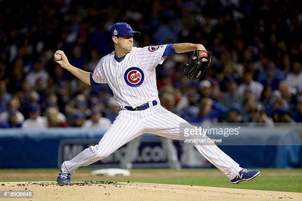 Kyle Hendricks of the Chicago Cubs pitches in the first inning against the Cleveland Indians in Game Three of the 2016 World Series at Wrigley Field...
