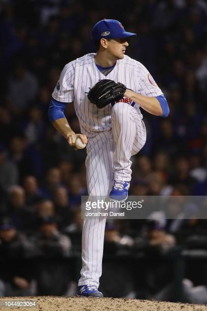 Kyle Hendricks of the Chicago Cubs pitches in the twelfth inning against the Colorado Rockies during the National League Wild Card Game at Wrigley...