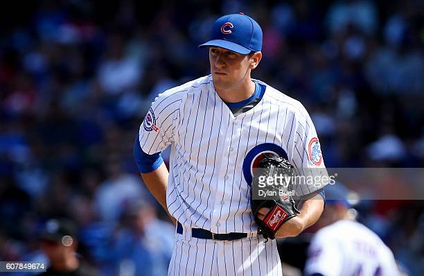 Kyle Hendricks of the Chicago Cubs reacts after giving up a run in the second inning against the Milwaukee Brewers at Wrigley Field on September 18...