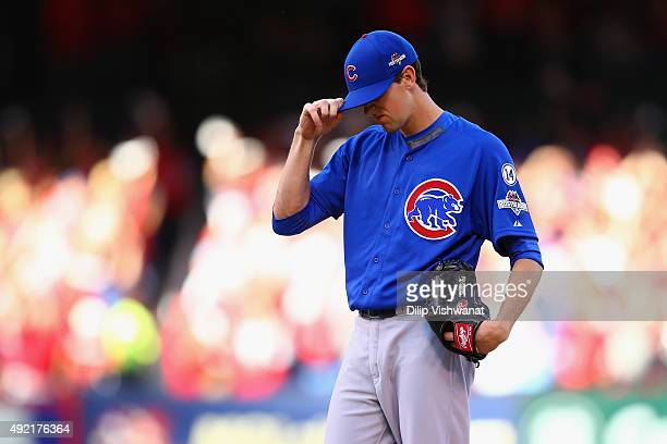 Kyle Hendricks of the Chicago Cubs reacts after giving up a solo home run to Matt Carpenter of the St Louis Cardinals in the first inning during game...