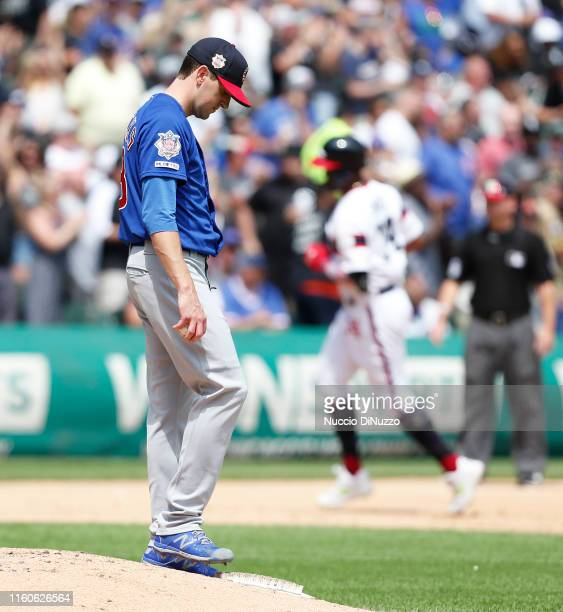 Kyle Hendricks of the Chicago Cubs reacts after giving up a two run home run to Eloy Jimenez of the Chicago White Sox during the fourth inning at...
