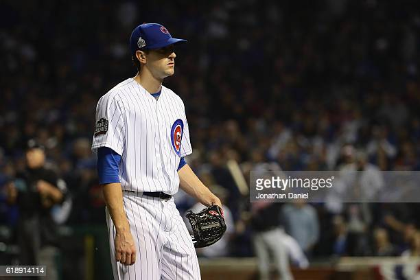 Kyle Hendricks of the Chicago Cubs reacts after giving up a walk in the fifth inning against the Cleveland Indians in Game Three of the 2016 World...
